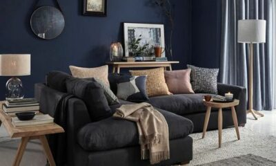 Bluish gray wall with black furniture